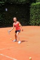 Elisa learning tennis