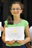 Elisa receiving the President's Award for Educational Excellence