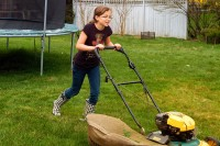 Elisa cutting the lawn