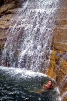 Elisa swimming under Trehman's Falls
